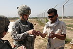 U.S. Army Capt. Bobbie Mayes, the women's empowerment coordinator for the Kentucky Agribusiness Development Team, and Mohammad Farid, the horticulture farm manager and project coordinator for Al-Bironi 100823-A-ZM120-005.jpg