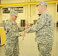 U.S. Army Col. Michael Berry, left, receives his commander's sword from Command Sgt. Maj. Bill Campbell during a change of command ceremony Dec. 7, 2013, in New Castle, Del 131207-Z-GL773-912.jpg