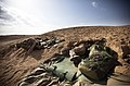 U.S. Marine Corps Lance Cpl. Christopher Rico, a mortarman with 81 mm Mortar Platoon, Weapons Company, 3rd Battalion, 3rd Marine Regiment, rests in a foxhole at his platoon's defensive position after a security 120212-M-MM918-008.jpg