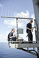 U.S. Navy Cryptologic Technician (Maintenance) 2nd Class Zackary Dangler, left, and Cryptologic Technician (Maintenance) 1st Class Craig Pitcher paint an antenna base aboard the amphibious assault ship USS 130429-N-AD372-107.jpg