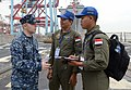 U.S. Navy Operations Specialist 1st Class Joshua Beck, left, gives a flight deck brief to Indonesian navy pilots aboard the guided missile destroyer USS Momsen (DDG 92) during Cooperation Afloat Readiness 130523-N-YU572-011.jpg