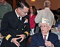 U.S. Navy Rear Adm. David F. Steindl, left, the commander of Naval Service Training Command, talks with Pearl Harbor survivor Tom Decker at the 42nd annual Pearl Harbor Day Memorial Luncheon at the Gaslight 111205-N-IK959-278.jpg