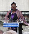 U.S. Rep. Gwen Moore's shawl blows in the wind as she speaks at a Tom Barrett rally at a downtown Milwaukee park. (7316883322).jpg