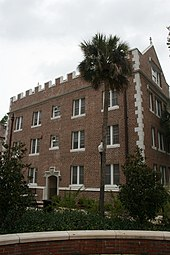 Exterior of Buckman Hall, a red brick and carved stone student residence hall at the University of Florida, built in 1905–06 in the then-popular collegiate gothic architectural style