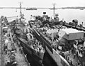 USS Claxton (DD-571), USS Canberra (CA-70) and USS Killen (DD-593) in floating dry dock ABSD-2 at Manus, 2 December 1944 (80-G-304096).jpg