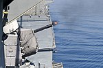 USS Monterey (CG 61) fires a CIWS. (8938604929).jpg