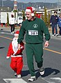US Navy 021223-M-9578B-006 Sailors, Marines, and their families participate in the 2002 Jingle Bell Jog.jpg