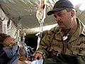 US Navy 030411-N-0728B-002 Lt. Dallas Braham from New Orleans, La., monitors an Iraqi woman at Fleet Hospital Three's (FH-3).jpg