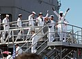 US Navy 030425-N-5067K-013 Sailors aboard USS Mobile Bay (CG 53) rejoice while walking off the brow to awaiting friends.jpg