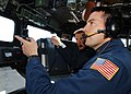 US Navy 030613-N-4374S-019 Lt. Cmdr. Ed Devinney, Executive Officer of the Aegis class, guided missile cruiser USS Vella Gulf (CG 72) is given a tour by the Lt. Cmdr. Jon Wikingsson, Executive Officer of the Swedish fast patrol.jpg