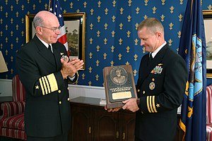 Vice Admiral James Bond Stockdale Award for Inspirational Leadership - Image: US Navy 031030 N 2383B 022 Adm. Vern Clark, Chief of Naval Operations (CNO) applauds Cmdr. Kevin J. Kovacich, former Commanding Officer of Fighter Squadron Two One One (VF 211) after presenting him with the Vice Adm. James Bond