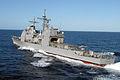 US Navy 040417-N-5781F-002 The Ticonderoga-class guided missile cruiser USS Vincennes (CG 49) steams away from USS Kitty Hawk (CV 63).jpg