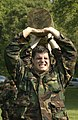 US Navy 040518-N-9693M-017 A Midshipman grimaces as he and his squad lift a log above their heads as part of Sea Trials.jpg