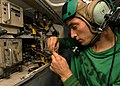 US Navy 041022-N-6651N-001 Aviation Electronics Technician 3rd Class Clint Pursley of Powder Springs, Ga., fixes the UHF-1 radio on a S-3B Viking.jpg