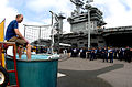 US Navy 050308-N-2143T-099 Executive Officer, USS Nimitz (CVN 68), Capt. Joe Clarkson, participates in a dunk tank competition to support fundraising for a Navy Marine Corp Relief Society drive.jpg