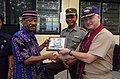 US Navy 050328-N-8629M-250 Commander, Task Group 73.1, Commodore Timothy McCully, presents a plaque to the Mayor of Alor, Indonesia.jpg