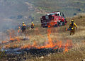 US Navy 050430-N-9500T-218 Firefighters assigned to Marine Corps Air Station (MCAS) Miramar Fire Department start a controlled burn using drip torches.jpg