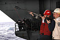 US Navy 050603-N-9551Z-028 Aviation Ordnanceman Airman Brent Earl prepares to shoot M-14 rifle with a MK-87 line kit attachment during a replenishment at sea (RAS) with the Military Sealift Command (MSC) underway replenishment.jpg