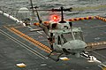 US Navy 051108-N-9866B-177 A UH-1N Huey helicopter, assigned to Marine Light Attack Helicopter Squadron Two Six Seven (HMLA-267), lands on the flight deck of the amphibious assault ship USS Peleliu (LHA 5).jpg