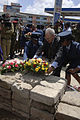 US Navy 060126-F-2902B-159 U.S. Ambassador to Kenya, William Bellamy, lays down a flower wreath near the destruction site during a memorial service.jpg