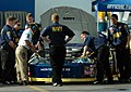 US Navy 060217-N-5862D-003 Members of JR Motorsports work on the No. 88 Navy Accelerate Your Life Chevrolet Monte Carlo on pit row before practice at the Daytona International Speedway.jpg