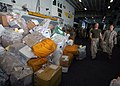 US Navy 060829-N-6403R-012 Piles of mail sit in the hangar bay after a vertical replenishment (VERTREP) with the Military Sealift Command (MSC) combat stores ship USNS Saturn (T-AFS 10).jpg