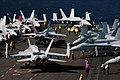 US Navy 061116-N-7782O-149 In a ballet of precision steps and movements, F-A-18 Hornets are maneuvered into parking positions on the flight deck of USS Ronald Reagan (CVN 76) following a cyclic flight evolution.jpg