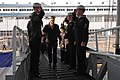 US Navy 070201-N-7883G-012 Adm. Timothy Keating, commander of North American Aerospace Defense (NORAD) and U.S. Northern Command, salutes while passing through side boys aboard USS Kitty Hawk (CV 63).jpg