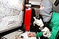 US Navy 070203-N-4009P-176 Mass Communication Specialist 2nd Class Christopher Blachly from Ridgecrest, Calif., receives a message in a repair locker during a general quarters (GQ) drill aboard Nimitz-class aircraft carrier USS.jpg