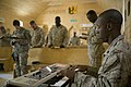 US Navy 070715-M-7772K-022 U.S. Marine Staff Sgt. Antoine T. Robinson, attached to Marine Regimental Combat Team (RCT) 2, plays a keyboard during a praise and worship service.jpg