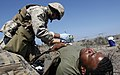 US Navy 070818-M-7747B-025 Hospitalman Jacob Hayes writes down the injuries of a simulated casualty during a mass casualty exercise.jpg