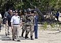 US Navy 070822-N-4267W-122 Secretary of the Navy (SECNAV) the Honorable Dr. Donald C. Winter walks with Builder 2nd Class Mike Carman as he describes the work Seabees with NMCB-7 and Amphibious Construction Battalion (ACB) 1 ar.jpg