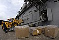 US Navy 070830-N-1810F-038 Sailors attached to amphibious assault ship USS Wasp (LHD 1) unload boxes of elementary school books for distribution to local schools as part of Project Handclasp, an initiative by the Navy to promot.jpg