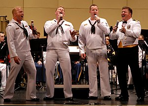 "Music theory - Barbershop quartets, such as this US Navy group, sing 4-part pieces, made up of a melody line (normally the second-highest voice, called the ""lead"") and 3 harmony parts."