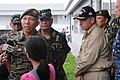 US Navy 080627-N-3659B-673 Gen. Alexander B. Yano, chief of staff, Armed Forces of the Philippines (AFP), discusses relief efforts with local media while Rear Adm. James P. Wisecup, commander, Carrier Strike Group (CSG) 7 looks.jpg