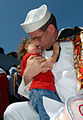 US Navy 080718-N-4879G-388 A Sailor assigned to the guided-missile destroyer USS Cole (DDG 67) holds his daughter at the pier during the ship's return to Naval Station Norfolk.jpg