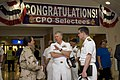 US Navy 080811-N-8273J-187 Chief of Naval Operations (CNO) Adm. Gary Roughead, center, speaks with Lt. Cmdr. Amanda Brookes and Capt. John Oberest while touring facilities at Naval Forces Central Command.jpg