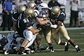 US Navy 091003-N-3404S-129 U.S. Naval Academy Midshipmen stop U.S. Air Force Academy running back Jared Tew.jpg