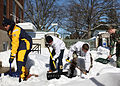 US Navy 100211-N-3879H-006 U.S. Naval Academy midshipmen lend a hand by shoveling sidewalks and helping stranded motorists in the streets surrounding the campus.jpg