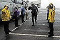 US Navy 100302-N-3038W-118 Rainbow side boys render honors to Rear Adm. Robert P. Girrier aboard the aircraft carrier USS Nimitz (CVN 68).jpg