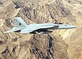 US Navy 100309-N-0000S-003 An F-A-18E Super Hornet assigned to the Pukin Dogs of Strike Fighter Squadron (VFA) 143 flies over the mountains of Afghanistan.jpg