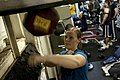 US Navy 100414-N-5712P-102 Aircrew Survival Equipmentman Airman Brittany Watson, from Ashville, N.C., hits the speed bag in the gym aboard the amphibious assault ship USS Nassau (LHA 4).jpg