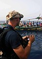 US Navy 100519-N-1082Z-014 Gunner's Mate 3rd Class Justin L. Myers takes notes as the team visits with fishing dhows while conducting maritime security operations.jpg