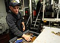 US Navy 101018-N-5016P-251 Gas Turbine System Technician (Mechanical) Fireman Noah Seiling sorts through his toolbox aboard the guided-missile crui.jpg