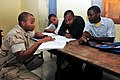 US Navy 110125-N-8366W-152 Petty Officer 1st Class Albert Brown, assigned to Joint Civil Affairs Team (JCAT) 101, tutors English students.jpg