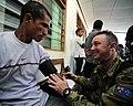 US Navy 110617-F-HS649-089 Australian Army medical assistant Cpl. David Keys checks vital signs on a Timorese man at the Zumalai medical civic acti.jpg