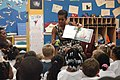 US Navy 110721-N-GZ984-125 First lady Michelle Obama reads to 5 and 6-year-olds at the Naval Air Station Oceana Child and Youth Programs summer cam.jpg