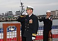 US Navy 111104-N-NW855-001 Cmdr. Bruce G. Schuette, oncoming commanding officer of destroyer USS Bainbridge goes aboard for the first time to take.jpg