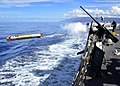 US Navy 111115-N-RI884-263 A MK 46 Mod 5A exercise torpedo is launched from the guided-missile destroyer USS O'Kane (DDG 77) during the integrated.jpg