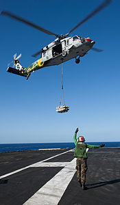 US Navy 120212-N-OY799-418 A Sailor directs an MH-60S Sea Hawk helicopter from the Eightballers of Helicopter Sea Combat Squadron (HSC) 8 during a.jpg